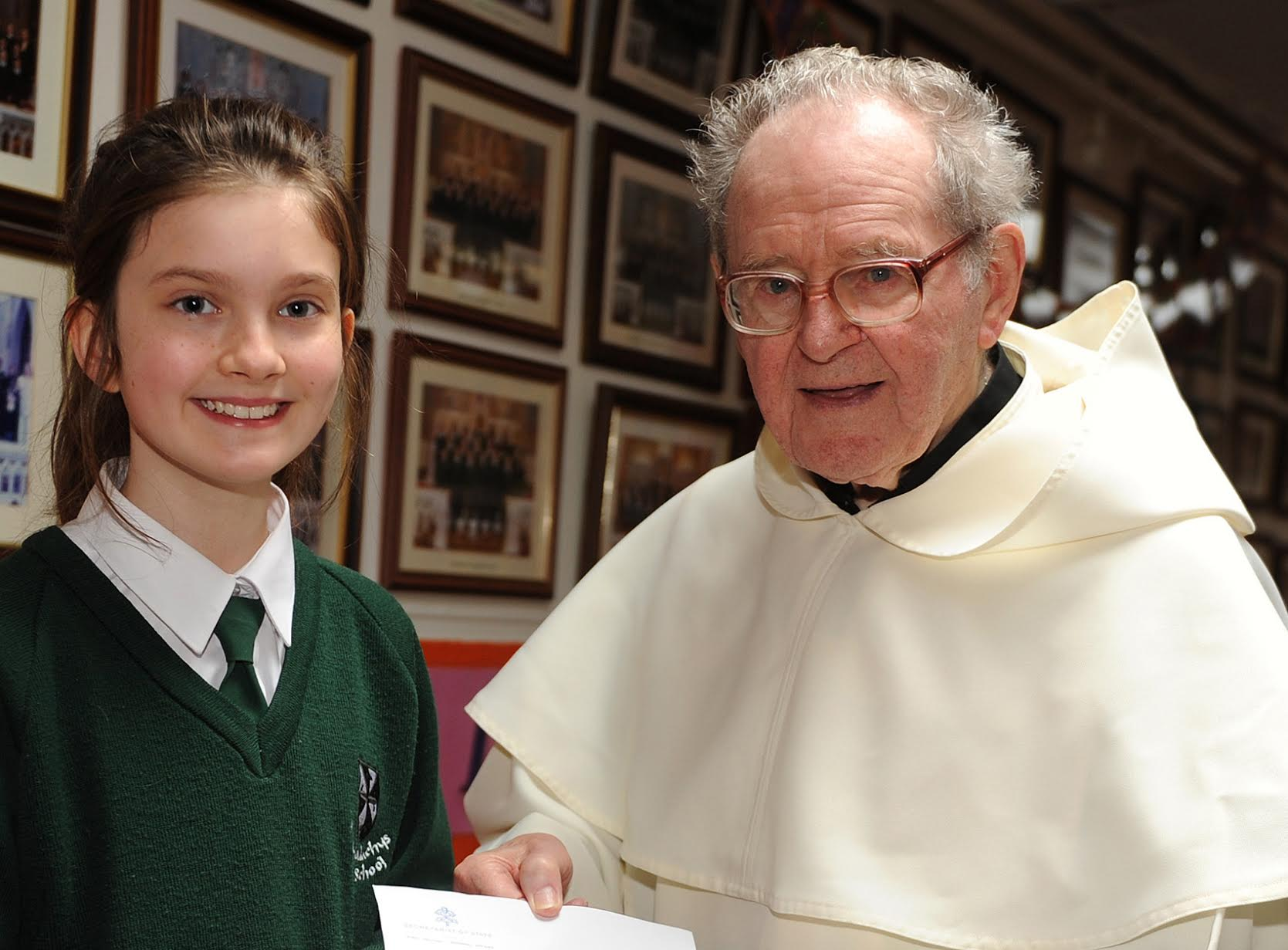 6th class pupil, Ruth McGee and Fr. Gabriel Harty OP in St. Malachy's Girls' National School.